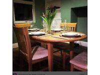 Oak extendable dining table with four chairs