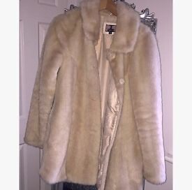 Women's cream fur coat