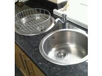 Kitchen sinks with taps