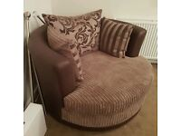 DFS cuddle swivel chair and foot puff
