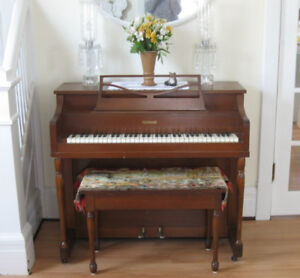 Rebuilt compact Melodigrand piano and bench