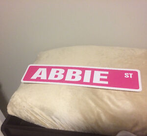 ABBIE ST. Sign