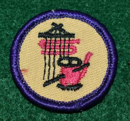 GIRL SCOUT WORLDS TO EXPLORE BADGE - TEXTILES & FABRICS - PURPLE