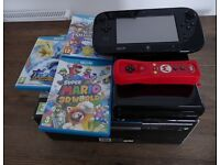 Nintendo Wii U console + Wii remote + Games boxed