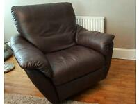 A pair of beautifully soft leather IKEA swivel recliners.