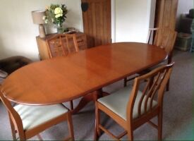 Extendable stag teak dining room table with 4 chairs