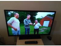 """Digihome 32"""" led backlit tv with excellent condition and remote"""