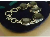 Silver & big black stones