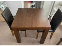 NEXT extendable dining table in Walnut with two chairs