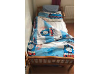 Pine toddler bed with mattress and bedding