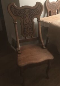 Hardwood table and carved chairs