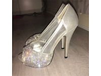 Silver high heels size 3