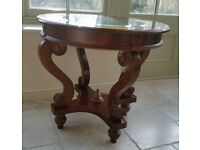 Round dark brown wooden Table with glass top