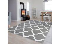 Grey white patterned short pile rug