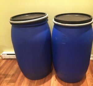 55 gallon plastic barrels with clamp lid, 50$ for both