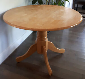 Round pedestal table, solid wood. Can deliver