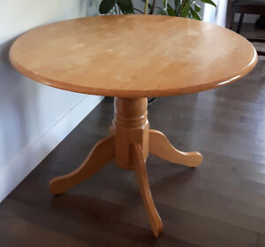 Round pedestal table, solid wood. Can deliver.