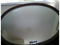Large Antique oval shaped bevelled edge mirror
