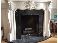 White timber/plaster fireplace/fire surround with black marble inner
