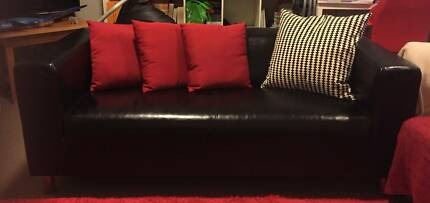 BLACK FAUX LEATHER SOFA & RED CUSHIONS FOR SALE (LIKE NEW)