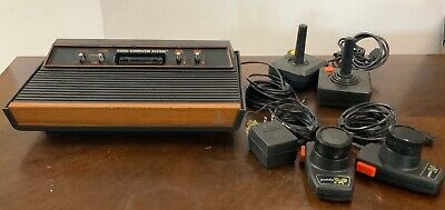 Atari 2600 Console Lot Tested And Works W/ 2 Controllers & Pong Paddle