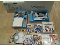 Nintendo wii complete console with games Nintendo wii fit board Nintendo wii wheel