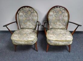 Pair of Ercol armchairs with original cushions