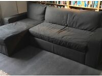 Charcoal fabric corner seat style sofa bed (double).