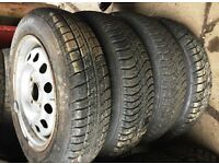 Set of 4 part worn ford steel wheels with 135 80 13 tyres
