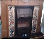 Electric fire with a fantastic surround and well crafted wooden fireplace. Very good condition.