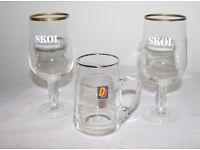 Two Skol International Glasses and One Double Diamond half pints