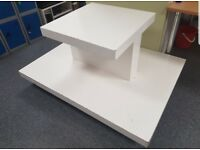 2 wooden square display units on wheels