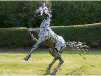 Reading metal horse garden sculpture