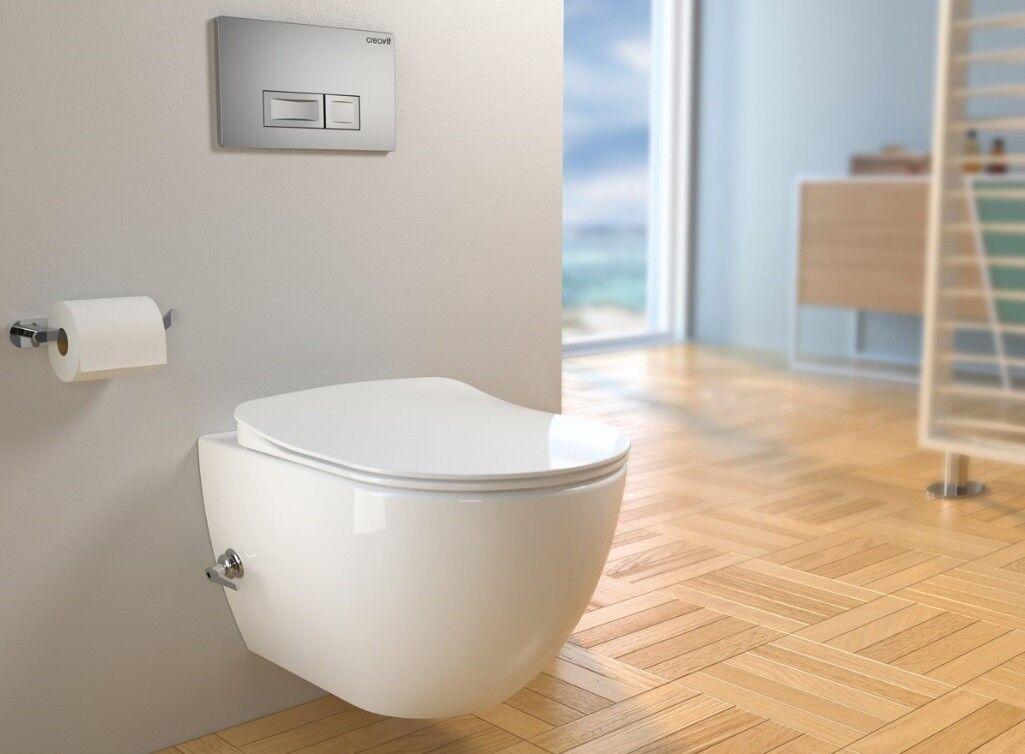 Hänge Dusch WC Taharet Bidet Toilette Spülrandlos Creavit mit Deckel + Schlauch