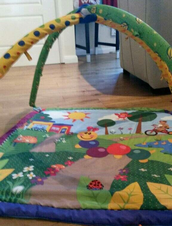 Playmat with hanging toys, lights and music