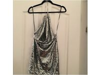 Silver sparkly plunge neck and backless dress