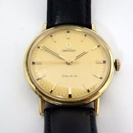 Omega : a gold plate Gents wristwatch , the signed circular dial marked ' Geneva ' with gilt batons