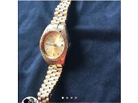 Genuine Ladies Gold and Diamond Rolex Watch
