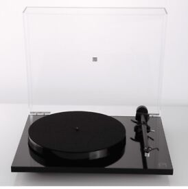 Boxed Rega Planar 1 turntable record player in black gloss