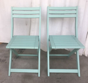 A pair of vintage folding patio chairs, new paint