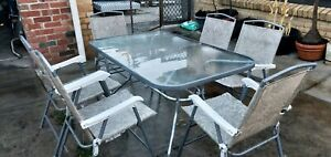 6 outdoor chairs, table 143×92×70cm height. Price firm no negatiable