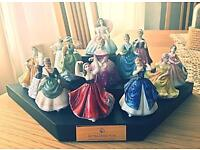 13 mini Royal Doulton figures with stand
