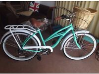 Green & White beach cruiser bicycle with front wicker basket