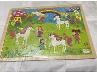 Various wooden jigsaws