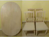 Light-coloured Oval Dining Table with 5 Matching Chairs