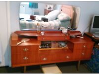 Vintage teak color bedroom dresser with large mirror