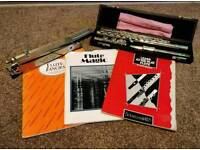 Silver flute complete with music stand and books