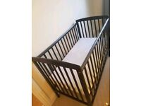 Black wooden baby cot and mattress