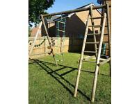 Wooden climbing frame swing