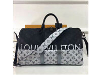 Louis Vuitton hold-all/duffles